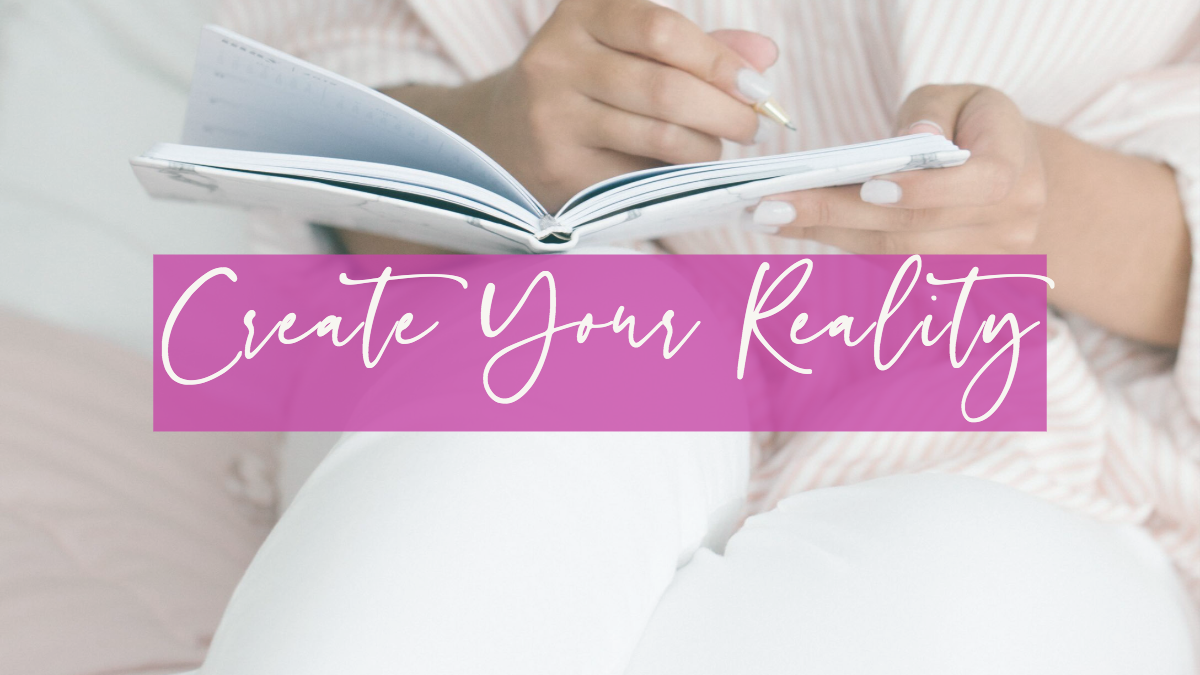 "woman journaling with ""Create Your Reality"" written across her lap"